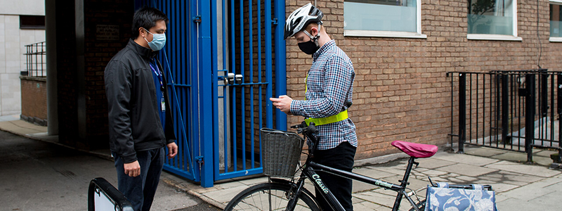 Photo of cyclist arriving at campus
