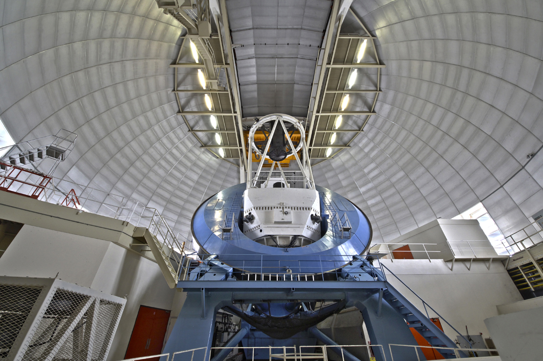 A wide-angle view of the NOAO Mayall 4-meter telescope on Kitt Peak National Observatory, P. Marenfeld & NOAO/AURA/NSF…