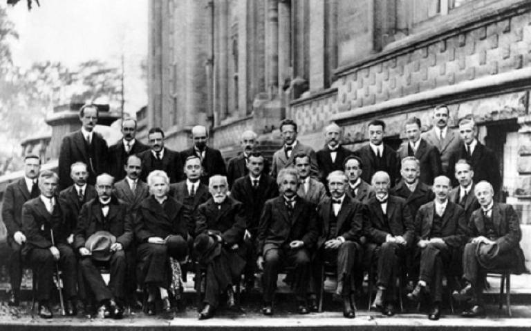 black and white photograph on male physicists wearing suits.