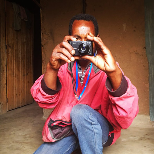 man with camera pointed at viewer
