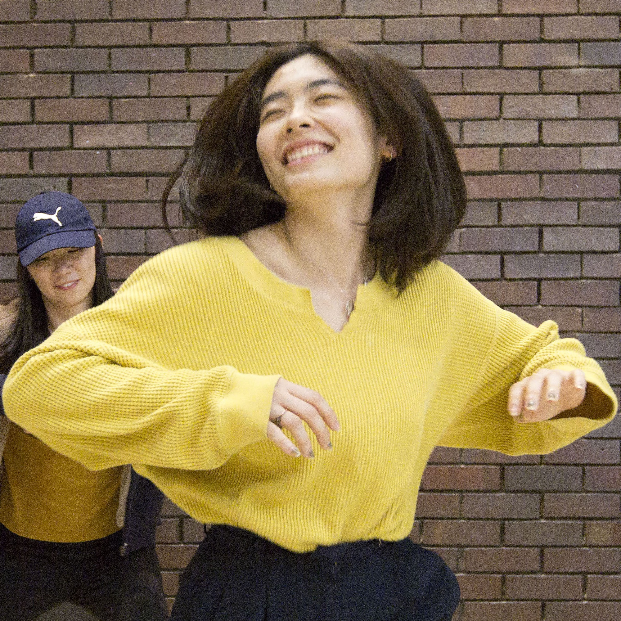 Colour photo of a dancer from the wait up, wearing a yellow top