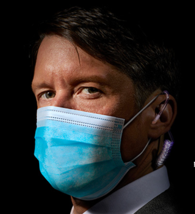 Jonathan Pie wearing a protective face mask