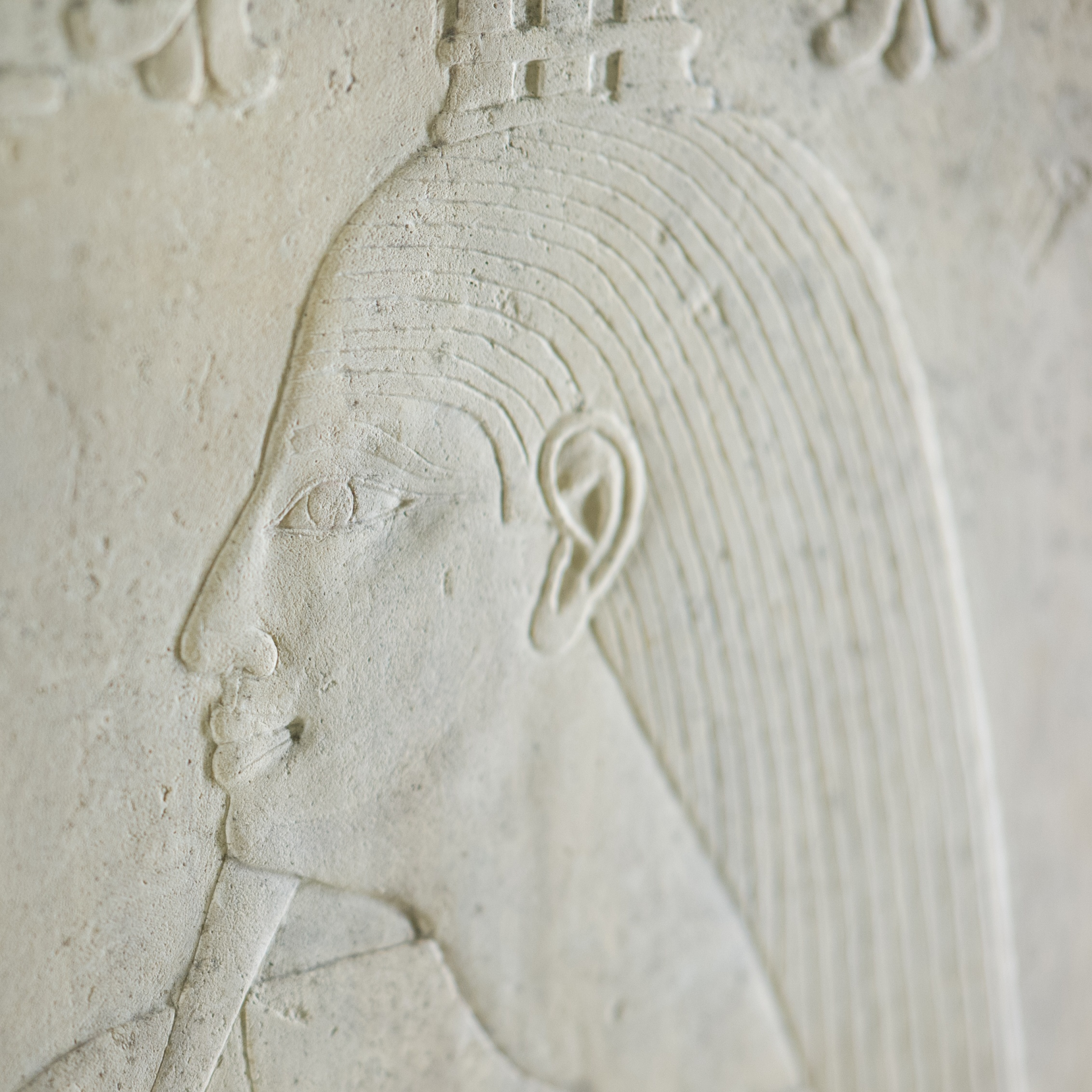 Colour photo of an ancient Egyptian stone carving showing a person in profile