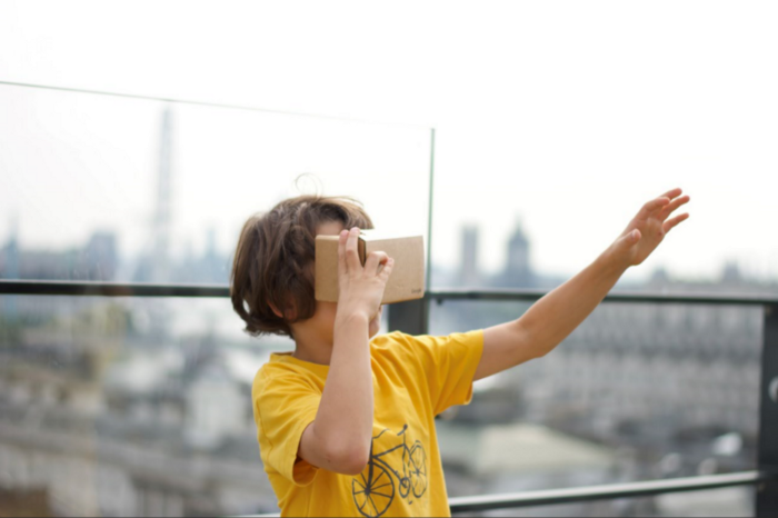 Young child looking into a virtual reality headset.
