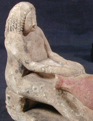 Image of limestone figure of a female potter frm ancient Egypt