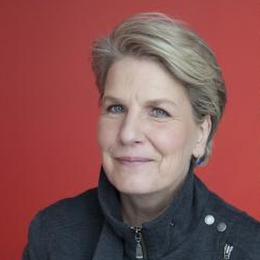 Close-up colour photo of Sandi Toksvig looking at the camera