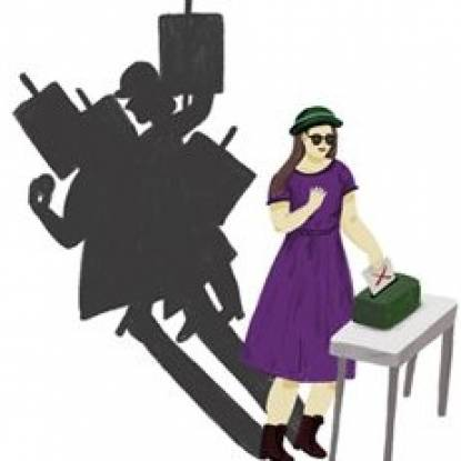 Colour picture of a woman posted her vote into a ballot box. Behind her are shadows of people holding placards