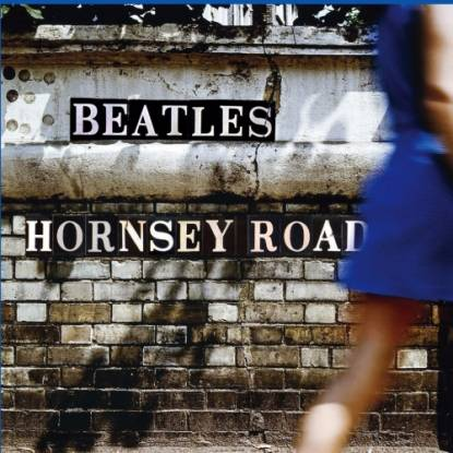 A brick wall with the words Beatles Hornsey Road printed on it