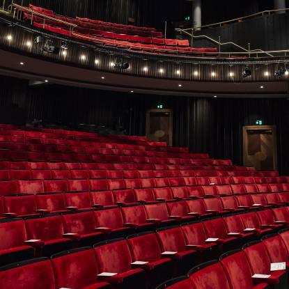 Colour photo of red theatre seats