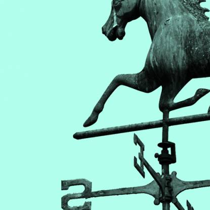 A horse weathervane in a blue wash of colour