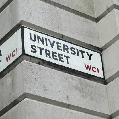 A wall-mounted street sign for University Street