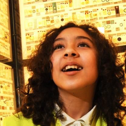 Girl looking in wonder at Grant Museum micrarium