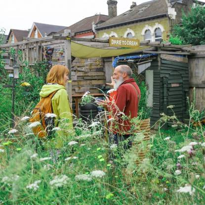 two project participants have a discussion in a garden