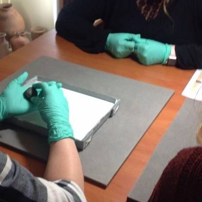 gloved hands discovering museum  objects