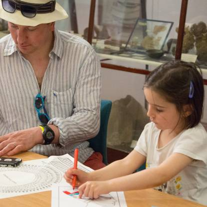 Adult and child taking part in Egypt themed craft activities