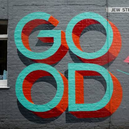 Text on a wall 'Good'