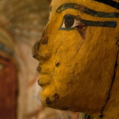 Colour photo of two mummy cases in profile