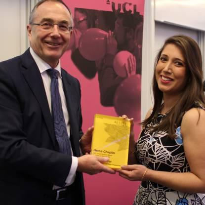 Provost handing an award to Hema