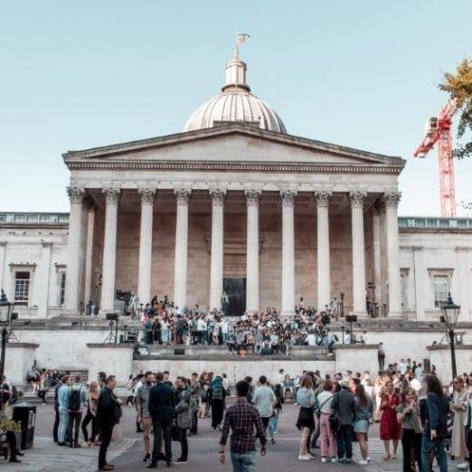 Colour photo of UCL main quad filled with people