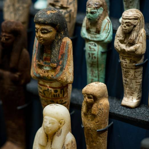 Colour photo of shabti figures arranged in rows