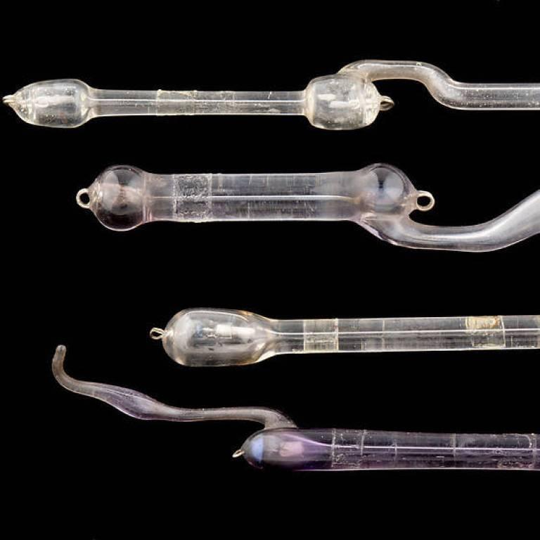 Four glass tubes