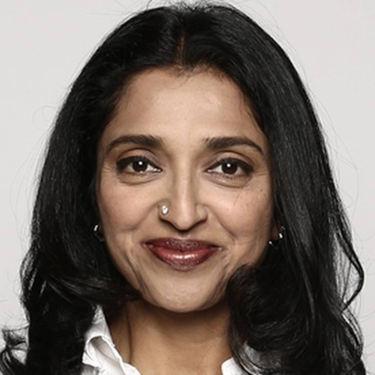 Headshot of Sindhu Vee wearing a white shirt