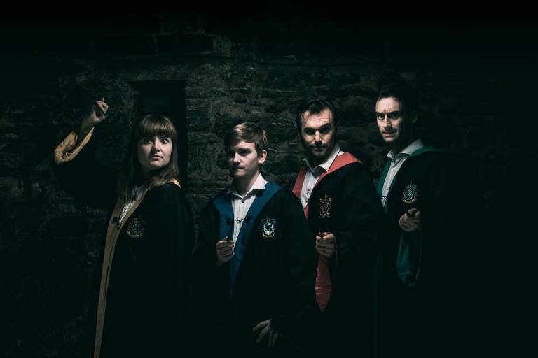 Four actors wearing Harry Potter robes