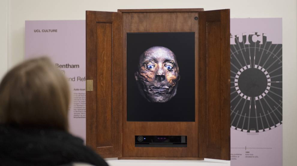 Colour photo of a digital portrait of Jeremy Bentham's head, projected in a wooden box