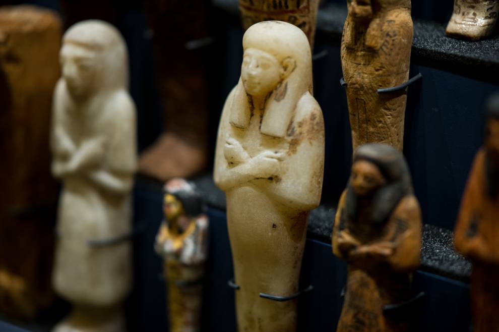 Colour photo of small ceramic Egyptian shabti figures, in human form