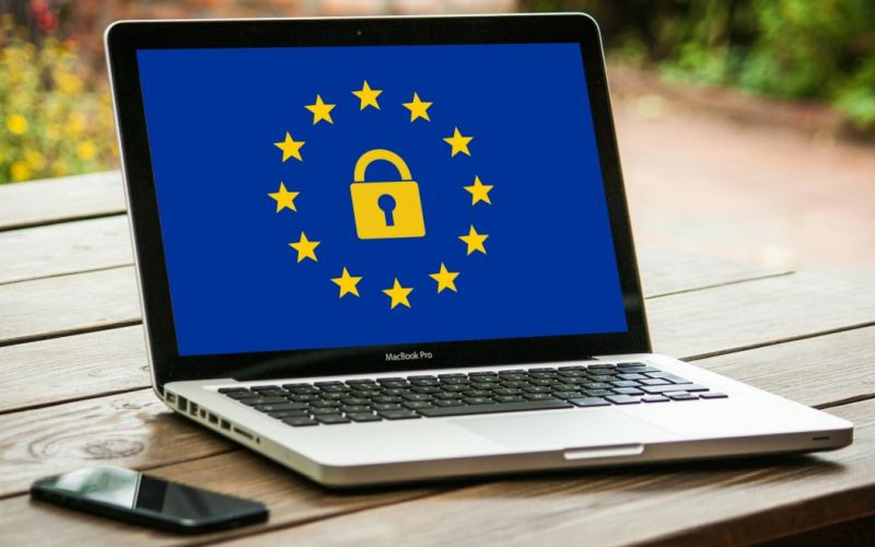 European Union flag and General Data Protection symbol on a laptop screen