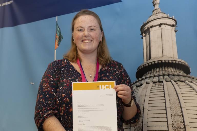 Caitlin Broadbent with her award certificate.