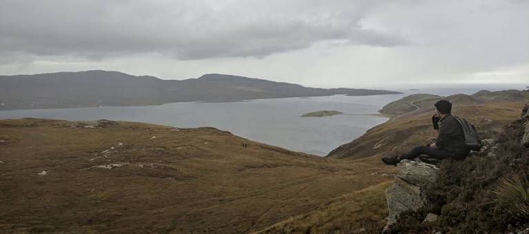 Arjun Anand, on a peak in Durness, Scotland.