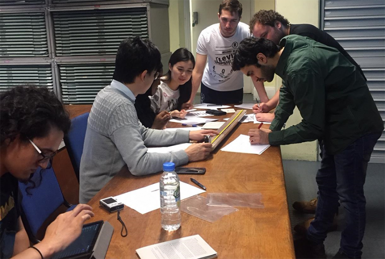 Geoscience students at UCL investigating a core replica documenting the PETM. Photo by Professor