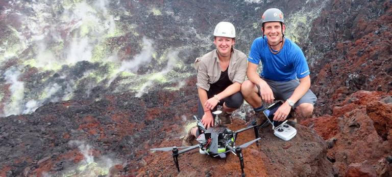 Emma Liu (left) and Kieran Wood with a multi-rotor drone on Rabaul Volcano