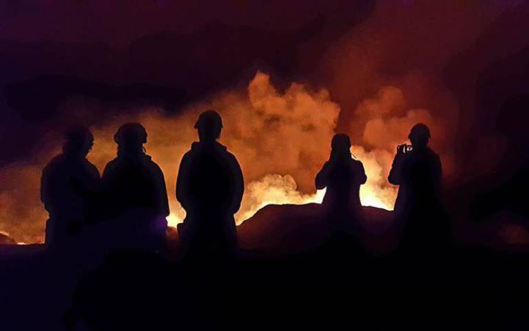 Caption: Volcanologists illuminated by the glow from the Kilauea lava flows (Photo: Dave Schneider, 2018)