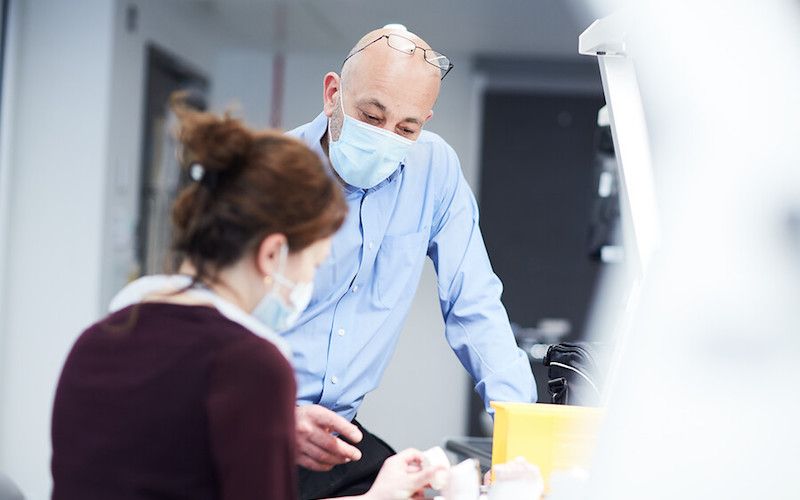 two people working in a dental lab