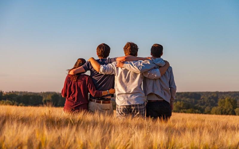 group hug in a field