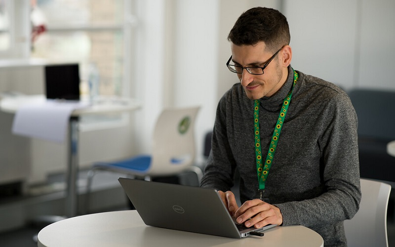 student studying on a laptop