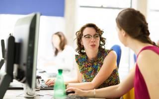 students talking at a desk