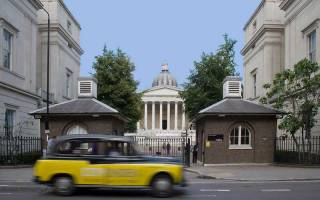 Taxi driving past the UCL Portico building