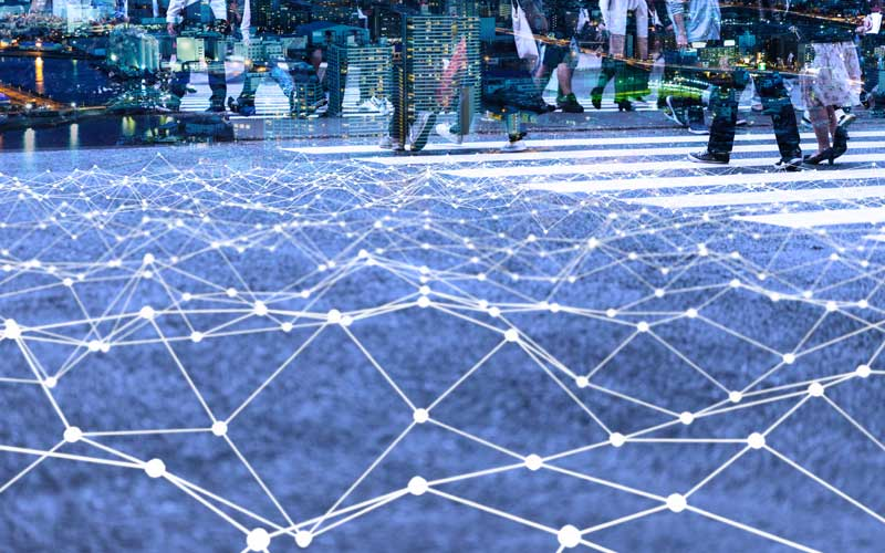 walking crowd over mesh of communication lines
