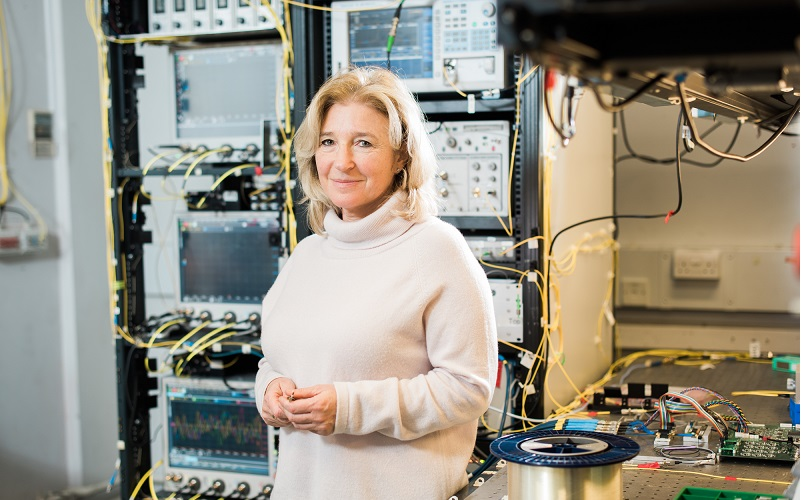 Professor Polina Bayvel standing in the optical networks lab
