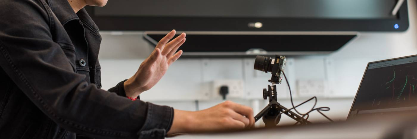 Researcher working with silicon camera