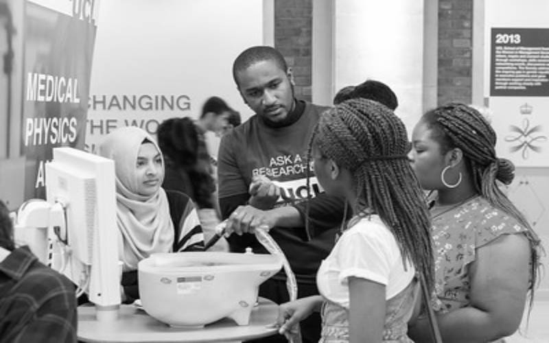 Students gather at a UCL stand