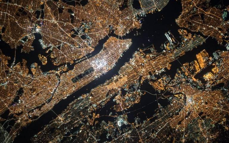 Aerial view of Manhattan at night, image taken by NASA, from Unsplash.