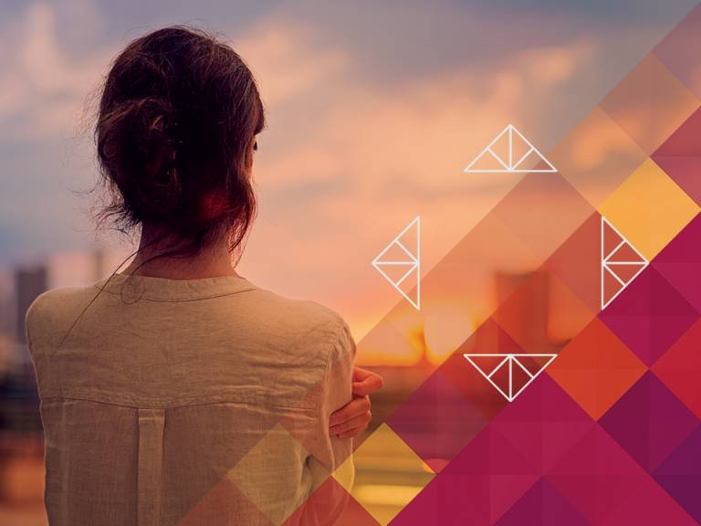 A woman facing away from the camera looking over a cityscape, with the UCL ID Hub triangles and warm colours in the bottom right of the frame.