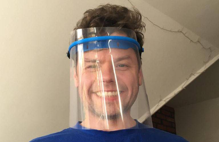 UCL engineering Daniil wearing a protective face visor he has 3D printed.