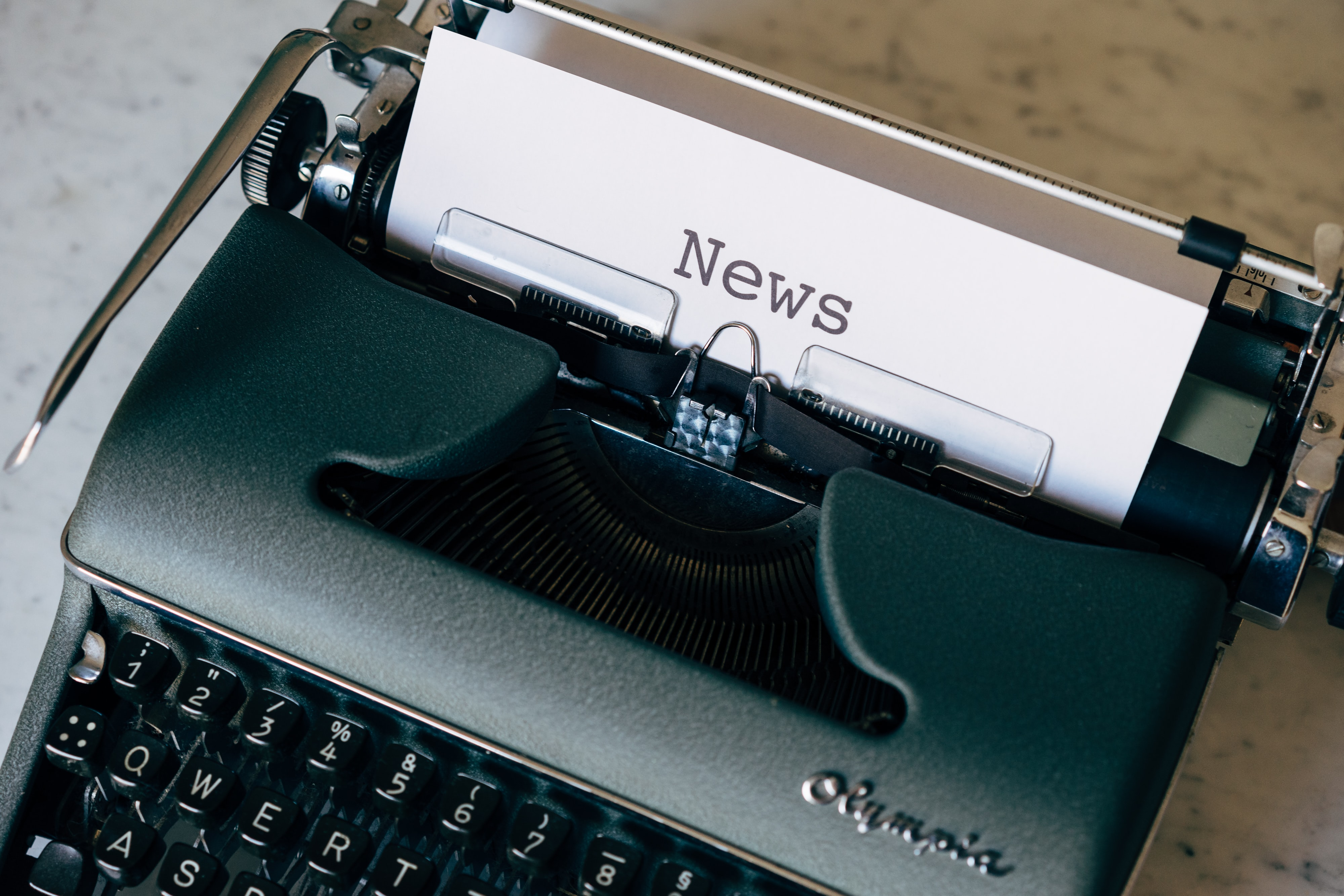 Image of typewriter with the word news printed on a piece of paper