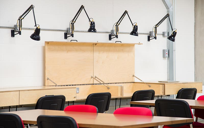 Row of empty desks at UCL BaseKX