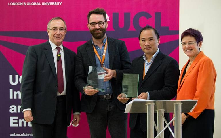 Dr Robert Thompson and Dr Kenneth Tong collect their award from President and Provost Michael Arthur and Dr Celia Caulcott, Vice-Provost (Enterprise)